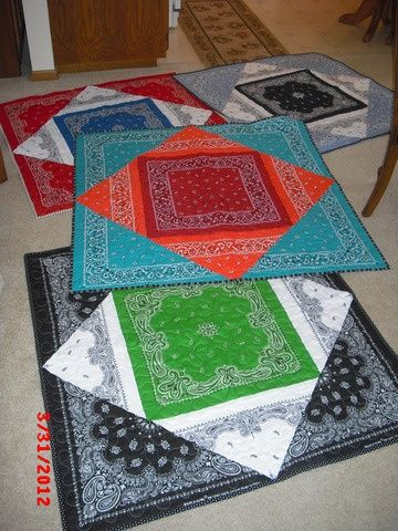 "Bandana quilts with only four bandanas! You need one for the center, one cut into fourths from the corners for the ""middle layer"" , and two cut in half from corner to corner for the outside corners."