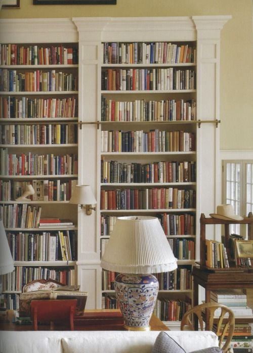 Floor to ceiling bookshelves are the sign of a classic and well read household. They add so much texture to a home