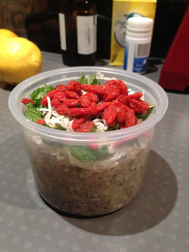 Chai apple pudding topped with coconut yogurt, goji berries and mint