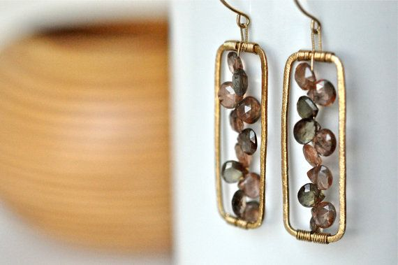 These spirited earrings are a delight to wear. The movement of the peach and hazel colored gemstones add whimsy to the geometry of the rectangular
