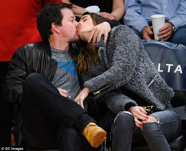 Mark Wahlberg and wife Rhea Durham exchange sloppy kiss at Lakers game #dailymail