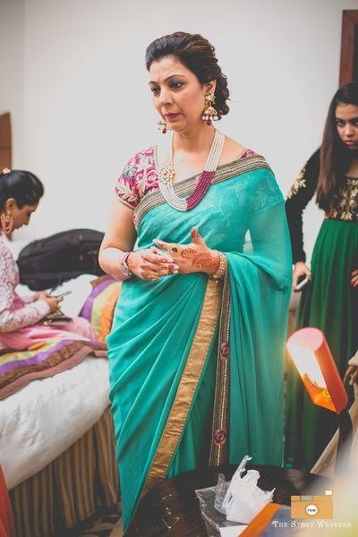 Turquoise saree for mother of the groom or bride   WedMeGood Find more wedding inspiration at www.wedmegood.co  #elegant #wedmegood #sari
