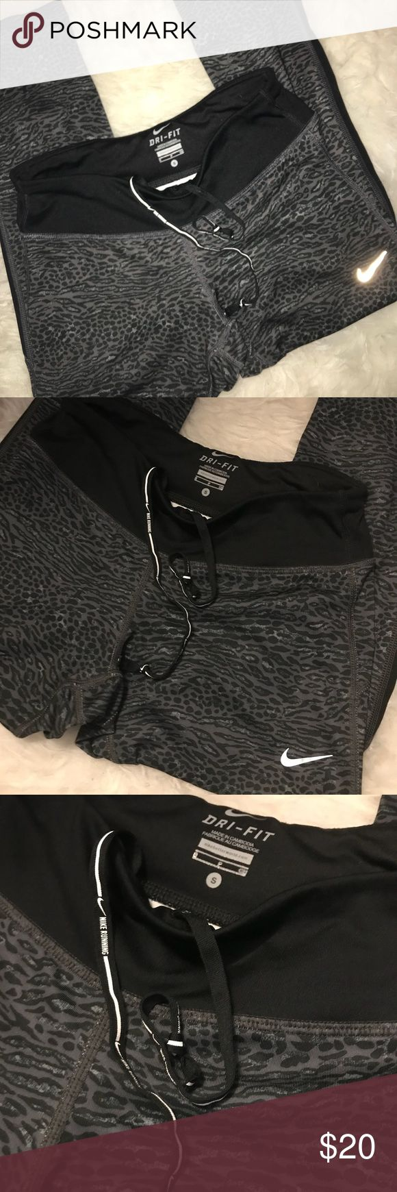 "Nike Leopard Print Leggings Great condition, 93% Polyester, 8% Spandex. Zip pocket at back, drawstring waist. Inseam approx. 21"", waist laying flat approx. 12.5"". Nike Pants Leggings"