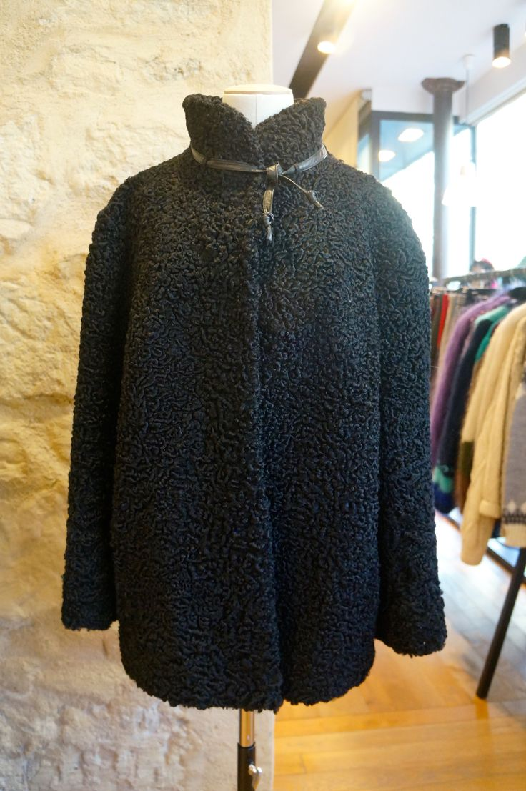 What a precious black astrakhan coat! Vintage 50's chic.