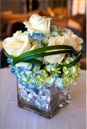 These floral Bat Mitzvah centerpieces had chocolate kisses in the bottom! | MItzvahMarket.com