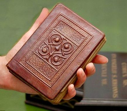 Europe's Oldest Known Book -- The 7th Century St. Cuthbert's Gospel (a copy of the Gospel of St John) was buried w/ St. Cuthbert on the island of Lindisfarne (off the coast of Northumberland) in about 698. His coffin was removed to Durham to preserve it from Viking raiders & the book was discovered when the coffin was opened at Durham Cathedral in 1104. This is the original red leather binding.