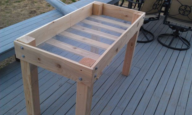DIY Raised planter bed.  The older I get the more I like the idea of raised beds!  This one is almost counter height!