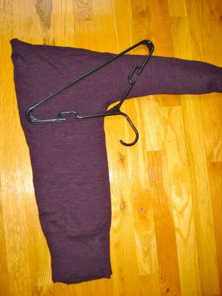 Hang a sweater without stretching it out.