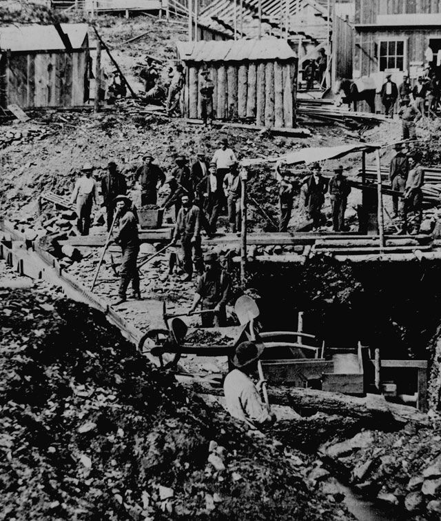 Mining crew drifting for gold below discovery point, Deadwood, Dakota Territory. Bystanders pose for photographer S. J. Morrow, ca. 1876. 165-FF-2F-10