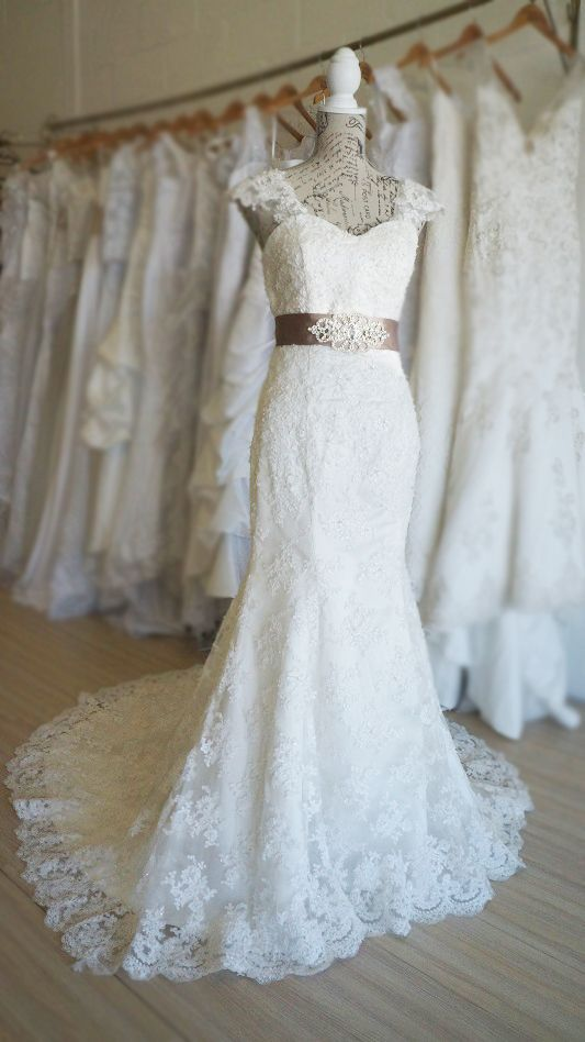 Vintage lace trumpet style wedding dress with delicate beading. Urban Bride Cape Town.