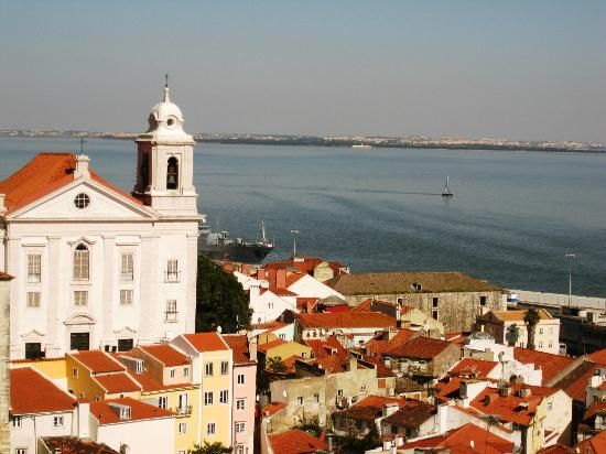 Alfama -- Authentic Lisbon neighborhood that keeps on going around corners, up stairs and always uphill. Orange trees, neighborhood cafes, great architecture and views. Nothing touristy about this neighborhood, just hundreds of years old houses.  Leave some time to explore.