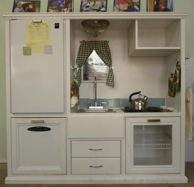 DIY Kid's kitchen reusing an old entertainment center. They found a mini fridge door that actually fit the space perfectly...cute! Lots of great ideas to go all out and they found all the pieces using a salvage store run by Habitat for Humanity..all proceeds from the sale of salvaged items go towards this charity!