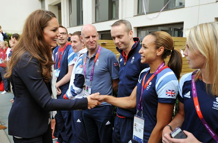 The Duchess of Cambridge shakes hands with Great Britain athlete Jessica Ennis during a visit to the Team GB accommodation flats in the Athletes Village at the Olympic Park in Stratford, east London.  PA Wire/Press Association Images