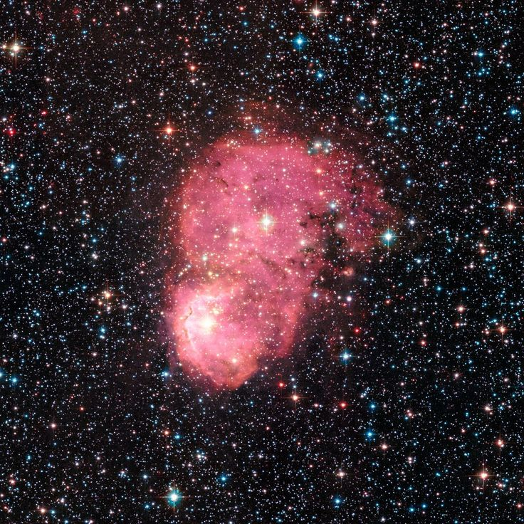 Festive nebulae NASA's Hubble Space Telescope captured two festive-looking nebulas, situated so as to appear as one. They reside in the Small Magellanic Cloud, a dwarf galaxy that is a satellite of...