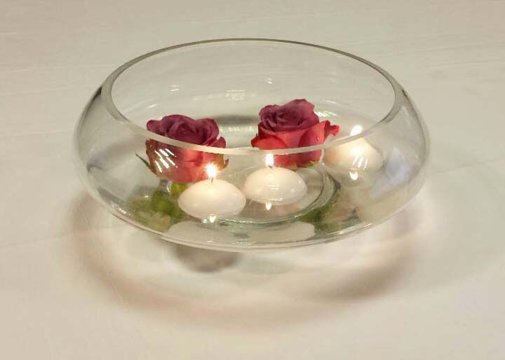 burgundy roses floating with candles.