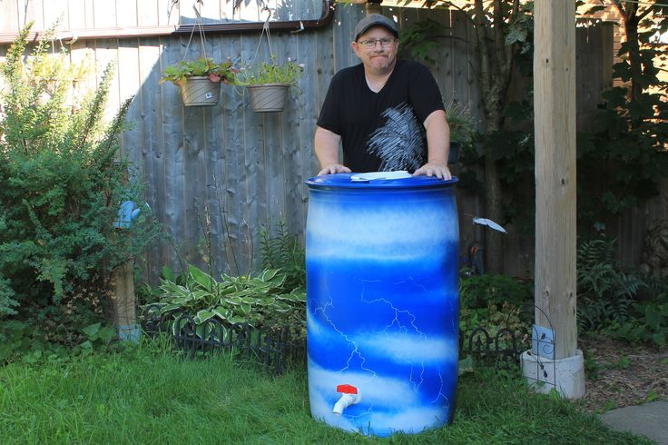 """-FOR SALE- Rain barrel #003 """"Lightning In A Barrel"""" Photo #3 of 3 Complete with 5' of overflow tubing, colored cleanable aquarium gravel filter system & all hardware parts are replaceable. One of a kind, hand painted with Krylon Fusion paint for plastic."""