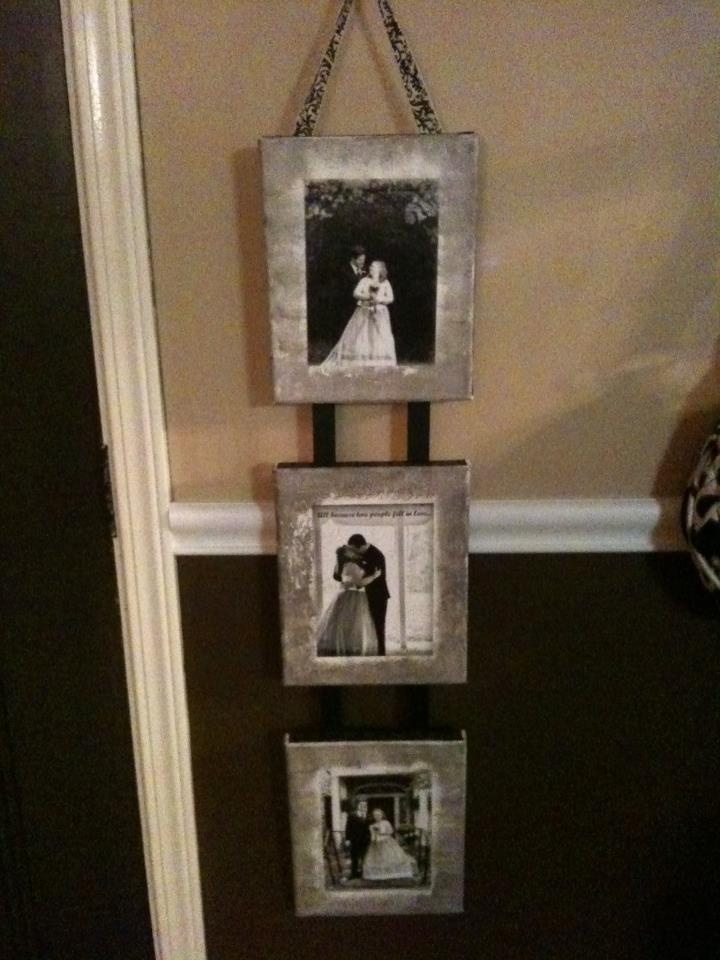 Canvas wedding pics hung with ribbon.  Anniversary present for friends.