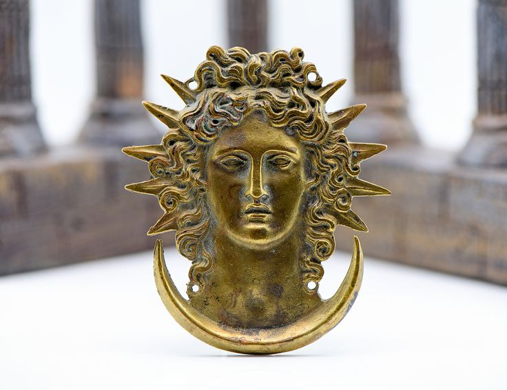 This is a striking and unusual artifact which holds in its binding the ability to contact and interact with a powerful Astral goddess whose name will be known to you only.  She is a single goddess of two personas; the Sun and the Moon.  In her manifestations she appears as a goddess of gold and silver locks of hair that reach beyond her feet.  She has one silver eye and one gold eye, she controls a gold flame which she holds in her right hand and a levitating pool of silver in her left…