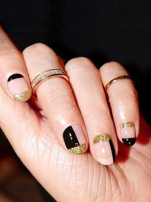 This geometric nail art is perfect for those of you looking for holiday manicure inspiration. With a colorblock design in black and glittery gold, it's sure to make a statement this season. Pair with sparkling rings for the ultimate party look.