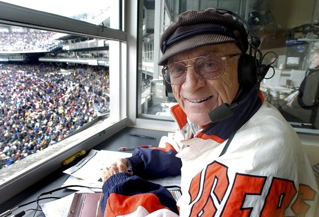 Tigers announcer Ernie Harwell in the booth at Tigers Opening Day on April 5, 2002. (Daniel Mears / The Detroit News)