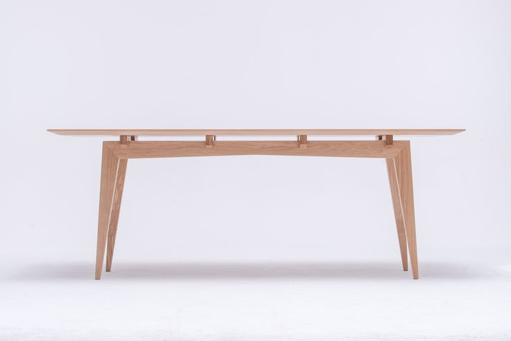 Tamaza Table, proj. Piotr Grzybowski, the first show - Abiente 2015, delicate feminine construction carries full loads The light construction of its long table legs gives the impression of gentleness and elegance. Don't be  deceived by the appearance, it is a powerful and reliable base. If you trust the modern charm of Tamaza, you can easily arrange any kind of a contemporary living room, dinning room or a kitchen. Functionality and modern design go together hand by hand.