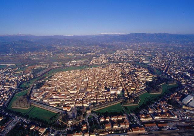 Lucca. A must see town in Tuscany. It's a gorgeous walled city, you can walk the wall all the way round, but i would suggest rather you spend your time visiting the amazing palazzo, and the Anfiteatro Romano. It has a wonderful history, great food and fantastic marketplace.