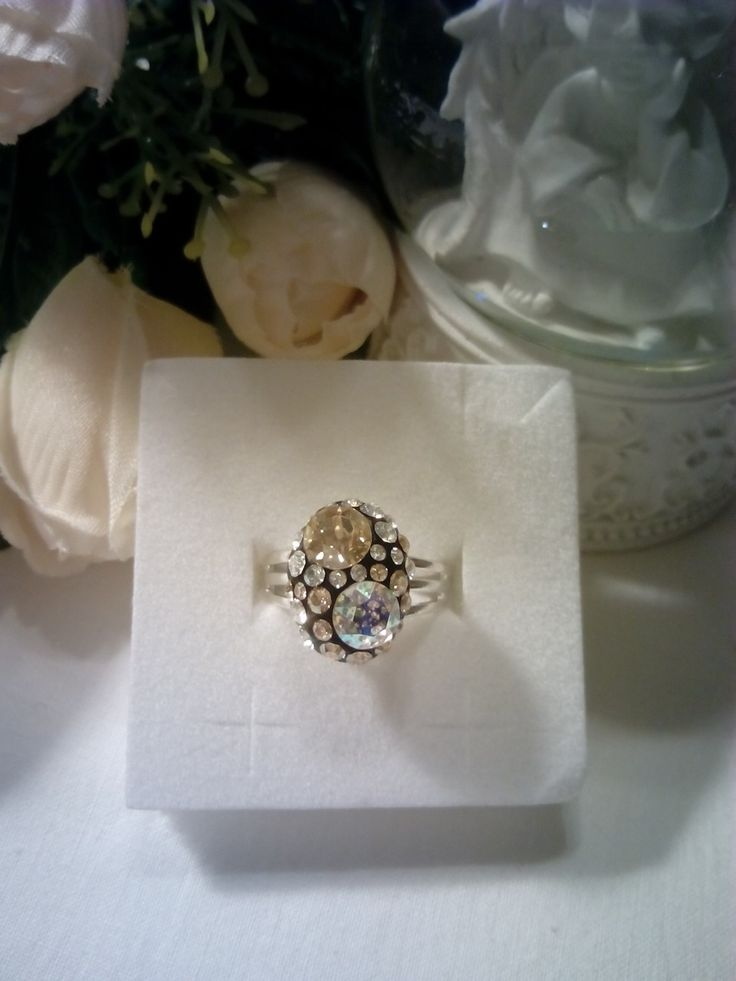 Silver plated ring with white patina and golden shadow Swarovski crystals.