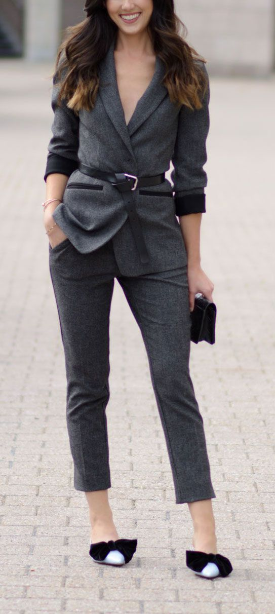 DYING over this unexpected way to wear a full woman suit!! Who would think wearing a belt over a jacket would look this cool?! Styled by Marie Ernst of Marie's Bazaar. Grey suit is from Le Chateau, bow kitten heels are from Zara. #suit #fashion #fashionblogger #style #work