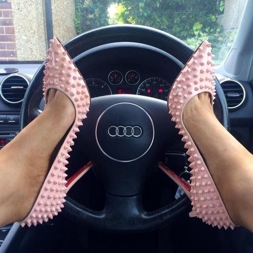 Is it bad that I'm most offended by her loubotins on that Audi?...I mean, respect it!: