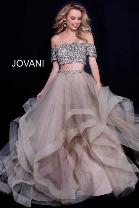 f7981dcd036ca6 Style 59755 from Jovani is an off the shoulder short sleeve 2 piece prom  gown with a beaded bodice and a sheer tiered skirt.