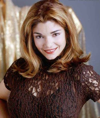 Laura San Giacomo. Great smile with a little gap. I notice she smiles with her mouth closed in most of her publicity shots so it's hard to find pictures with the gap.