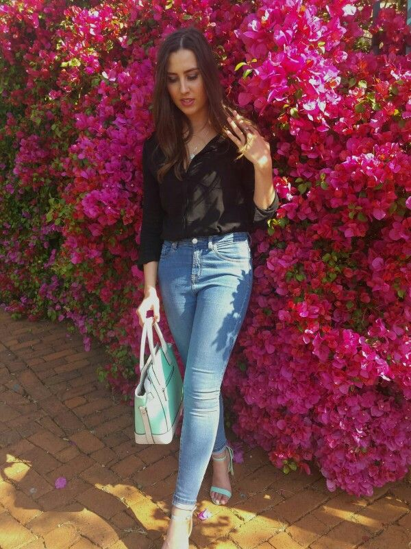 Spring look: Basic black blouse with high waisted blue jeans and turquoise handbag + heels. #streetstyle  Call it Spring : www.feliciadebeer.co.za