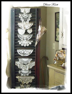 Old shutter displaying vintage doilies - SO CLEVER!  Great way to use doilies we no longer use!