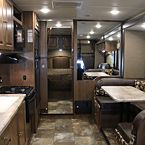 "Coachmen Leprechaun 319MB with fireplace, Electric lift 40"" TV, Outdoor Camp Kitchen, Swivel Captains chairs,"