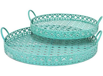 Redolent of gorgeous caning, the lattice-like metal work of these Turquoise Metal Trays add an airy elegance to the table. Set of 2. $115 Sale $65. Buy here.