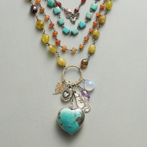 """HEARTFELT NECKLACE:   A necklace with heart and soul, made by Jes MaHarry and bearing a plump turquoise heart, blue chalcedony and amethyst, inscribed sterling silver charms, a 14kt yellow gold leaf and tiers of carnelian, turquoise, red and green garnet. Soft suede ties. USA. Exclusive. Approx. 40""""L."""