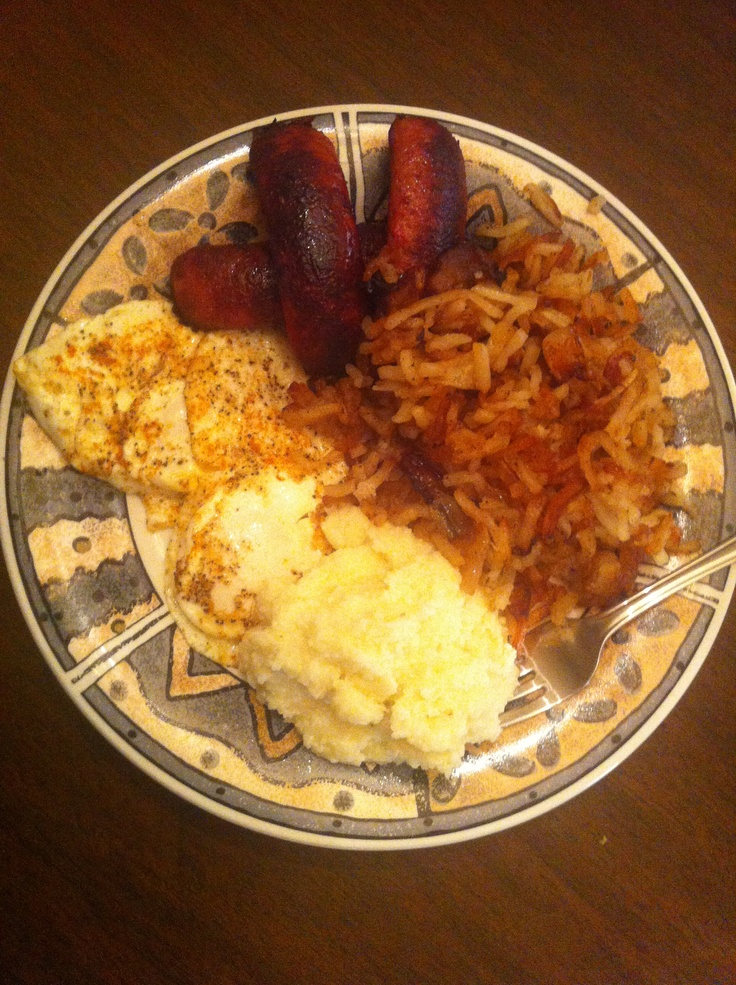 Southern breakfast! Eggs(over easy), red hot sausage, cheesy grits and homemade hash browns with onions.