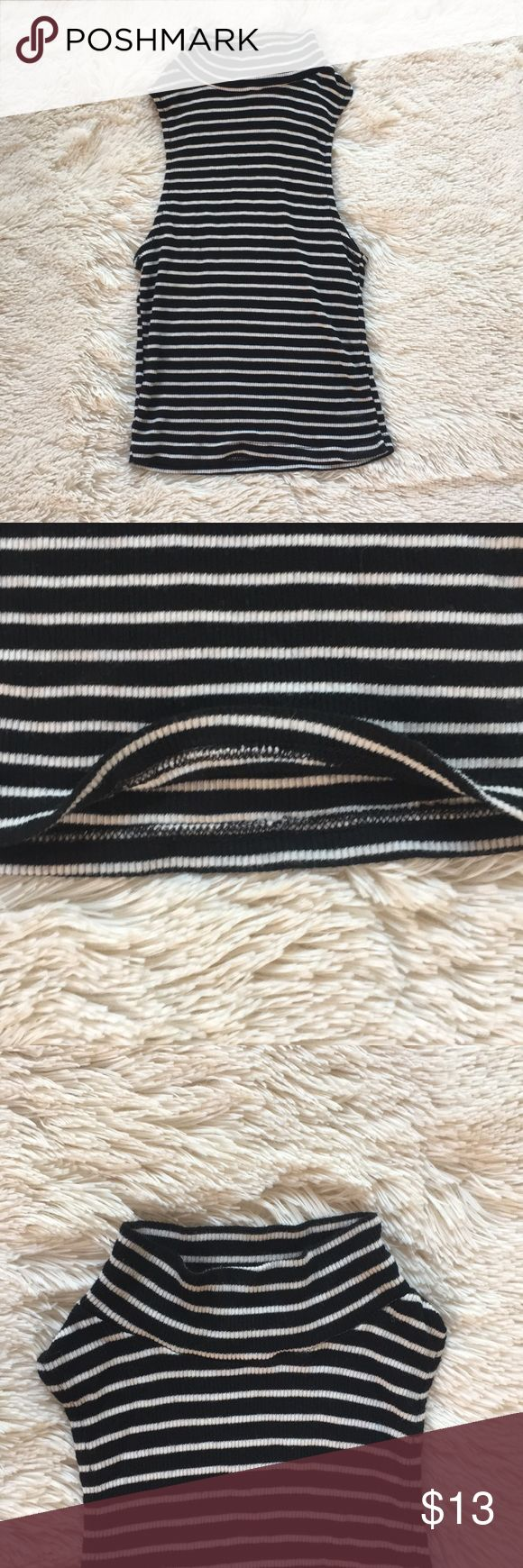 Sleeveless low cut tank top with stripes Super soft black and white striped tank top with a high neck  Condition: worn once all seams in tack   Size: one size fits all (maybe youth large but really stretchy   Looks: no rips, tears, or stains Brandy Melville Shirts & Tops Tank Tops