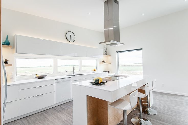 U Residence by 641 Homes... Cool kitchen windows, nice mix of greyish white flooring and warm wood island