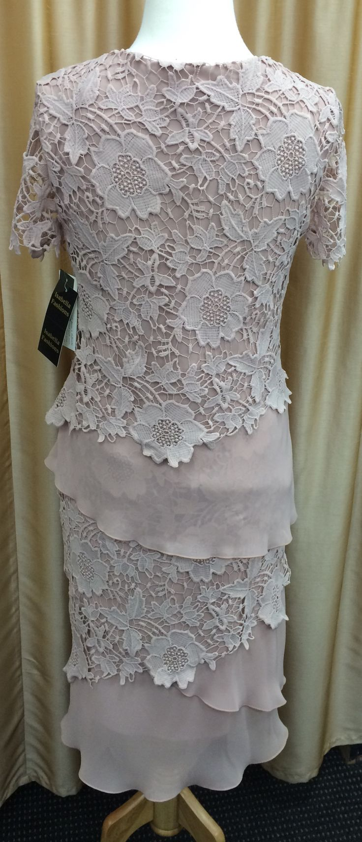 Fully lined dress Layers of chiffon and lace Lace sleeves Colour: Dusky Pink, also comes in Navy & Red Sizes:10 - 20  Our price: $339, bigger cut $369Sizes