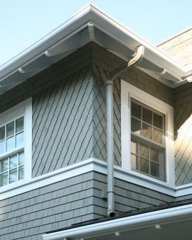 Exposed rafter tails decorative diamond shingles and the for Decorative rafter tails