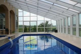 Lean to swimming pool enclosures, sloped glazing, glass manufacturer