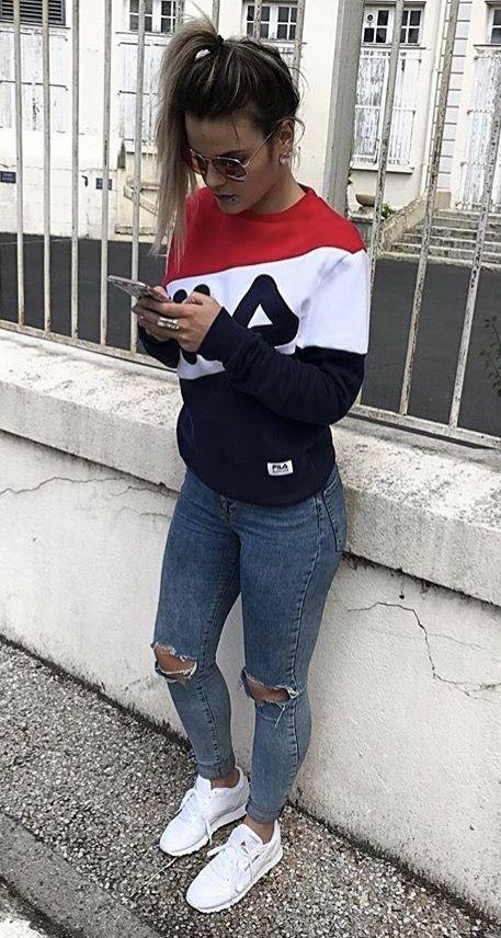 Outfit Fila sweater en skinny jeans