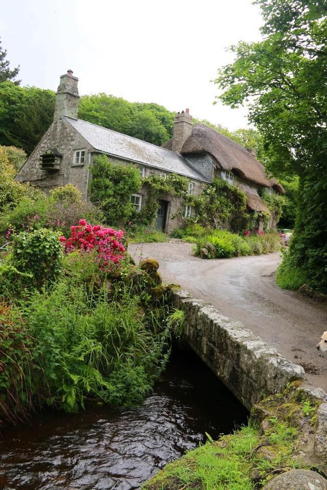 Rustic English village with thatched stone cottages