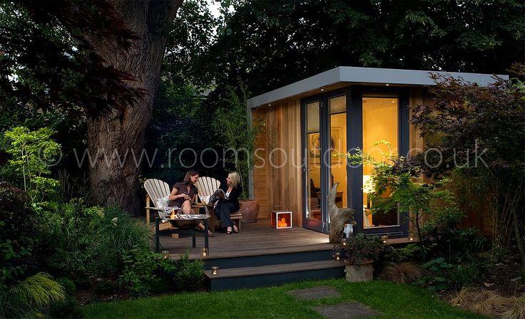 Nice seating area near tree and garden room