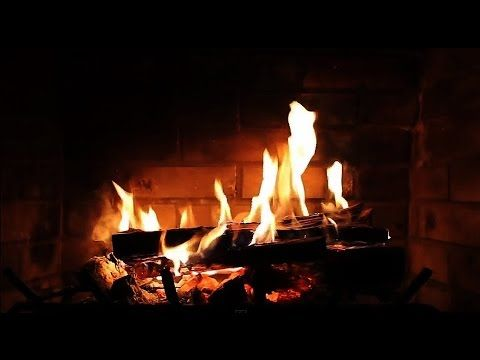 "Favorite! Put this on my TV this morning and it actually felt festive! ""Burning Fireplace with Crackling Fire Sounds (Full HD) - YouTube"""