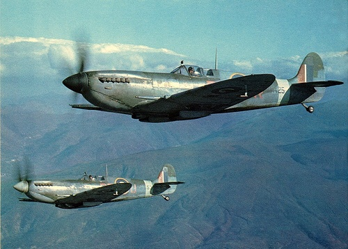 Spitfire mk. IX's in Italy  Two spitfires of 241 Sqn. on patrol over the mount Vesuvius area on Jan. 27th, 1944.