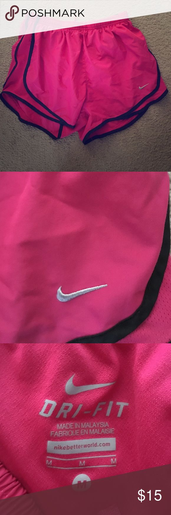 Nike Running Shorts Hot pink Nike shorts. Barely worn, these are great comfy running shorts Nike Pants Track Pants & Joggers