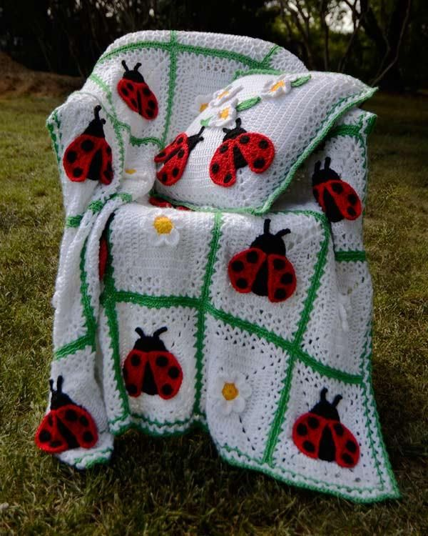 Watch Maggie review this adorable afghan! Crochet Design by: Maggie Weldon  Skill Level: Intermediate Size: Afghan: 42″ x 63″; Pillow: 18″ square Materials: Wo