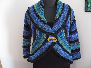This is a stash-busting pattern for making your own custom circular shrug to your measurements using whatever yarn you wish. Pattern gives easy formulas for fitting and calculating sweater dimensions to match your yarn, starting from a gauge swatch.